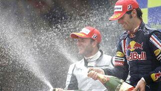 Rubens Barrichello, segundo, y Mark Webber (Red Bull), tercero.  Foto: Reuters / AFP Photo / EFE